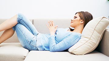 Woman relaxing on a sofa
